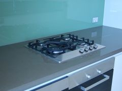 stovetop with marble bench and splashback